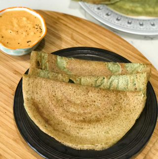 A plate of food on a table, with Dosa