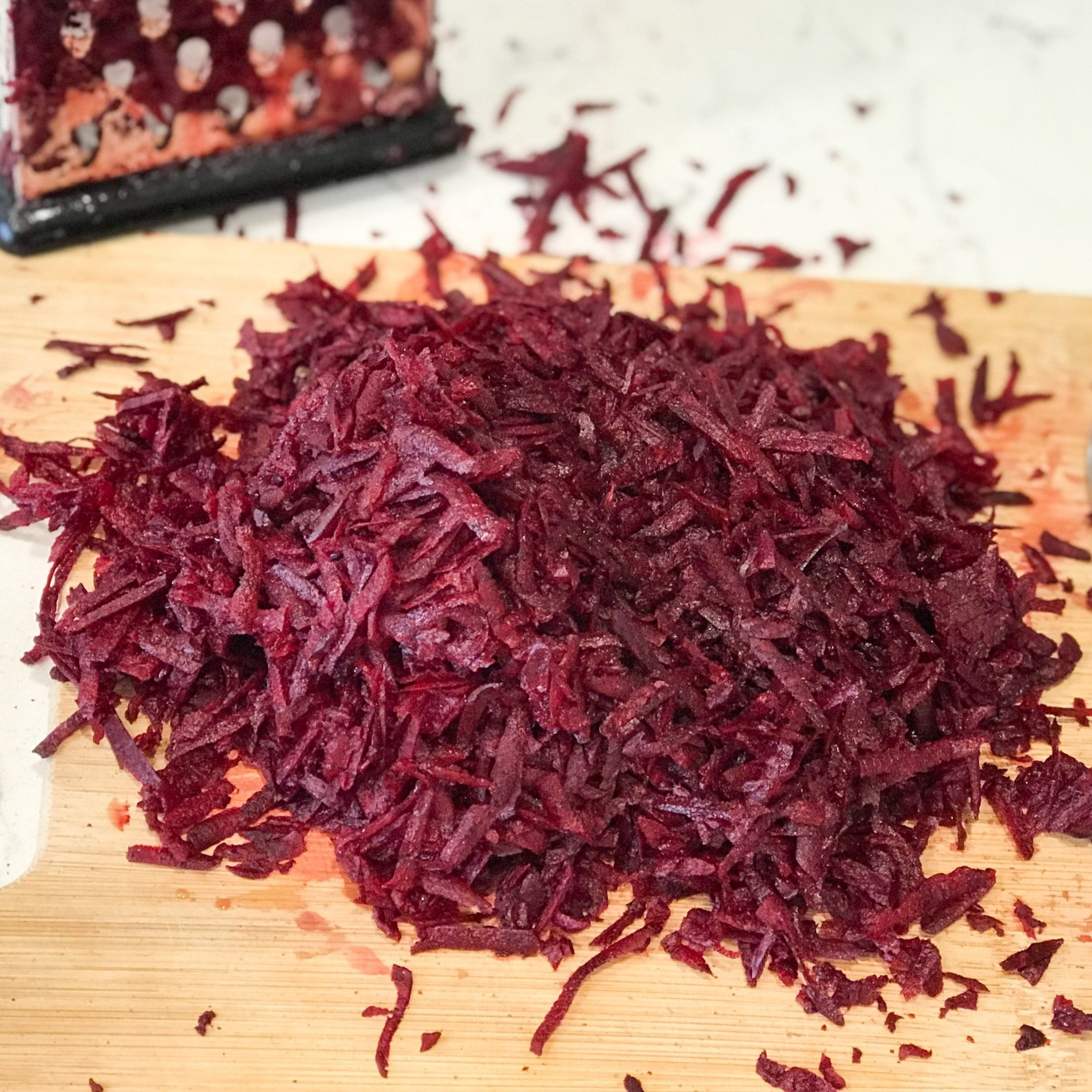 Grated beets is on the cutting board