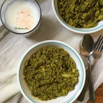 A bowl of spinach quinoa and with glass of butter milk