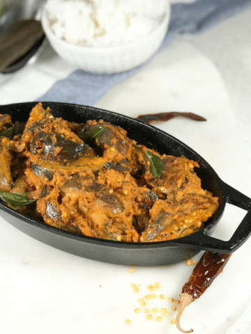 A plate of masala curry is on the table.