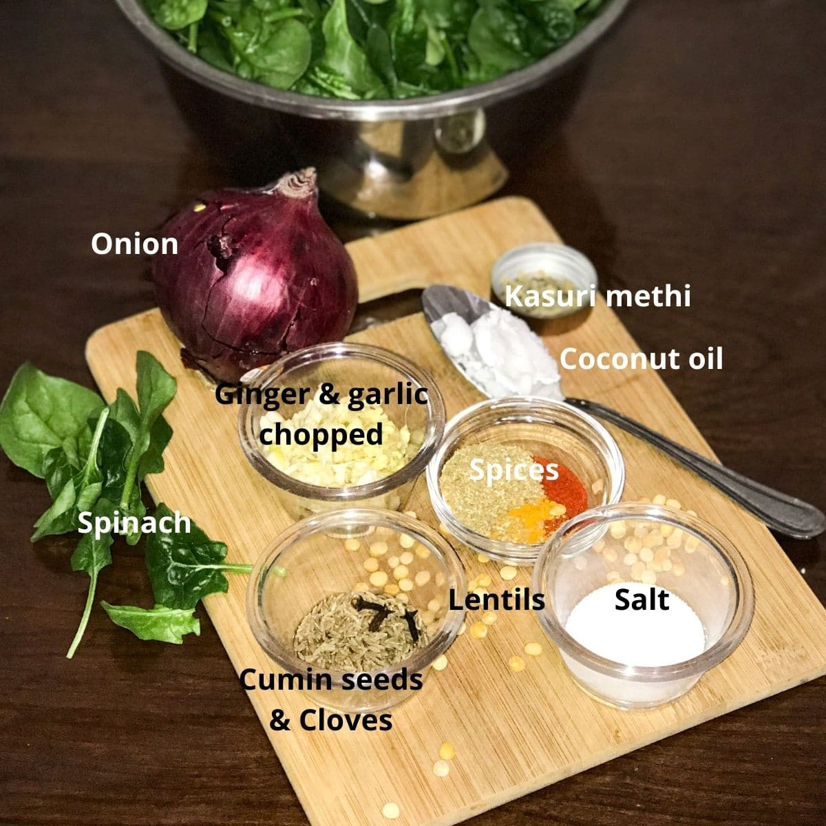 all the ingredients are placed on the table for spinach dal