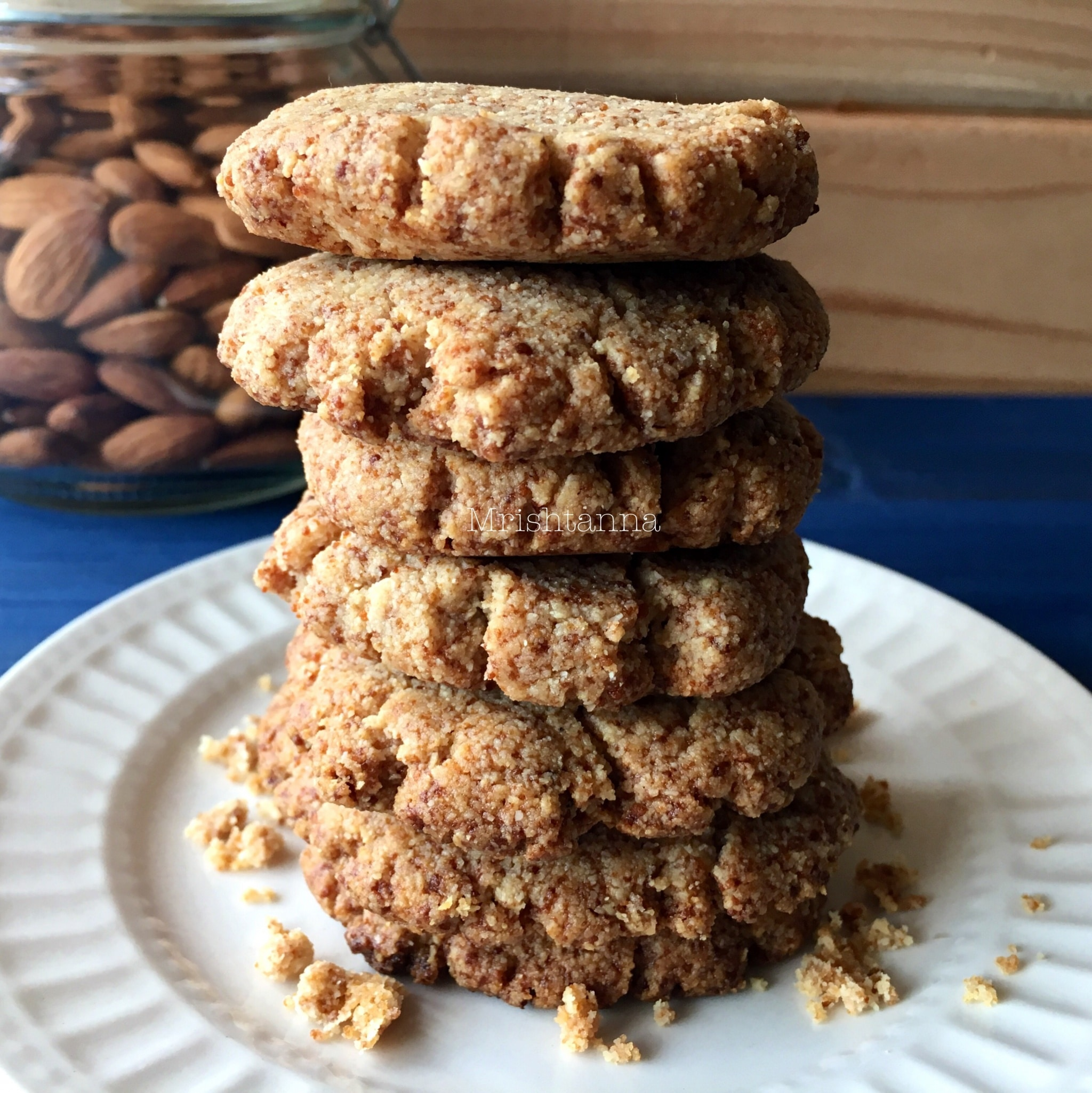 Stacked vegan almond flour cookies on the table