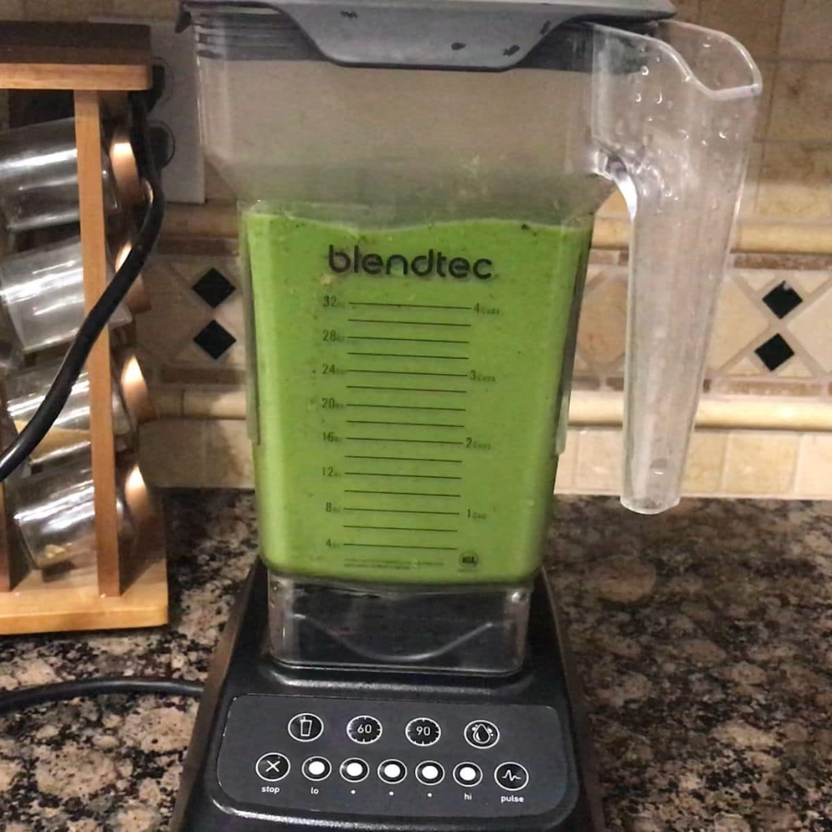 A blender filled with spinach and boiled potatoes