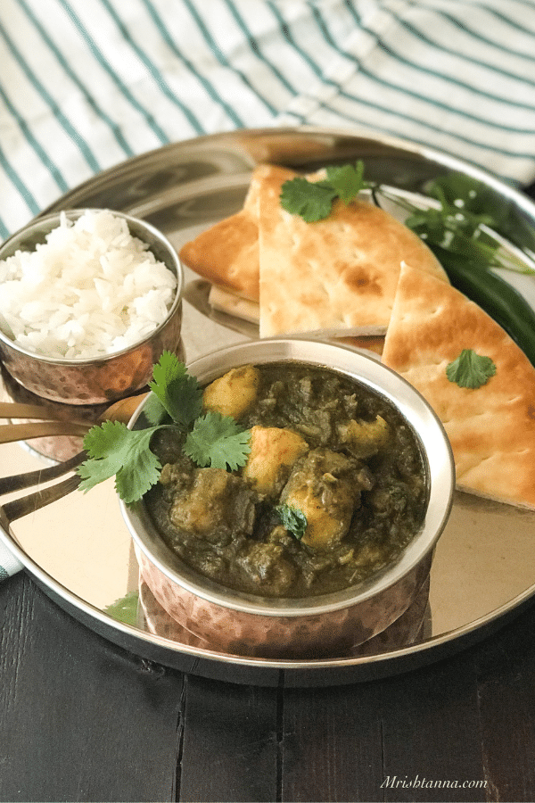 A bowl of food on a plate, with Curry