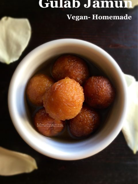 A bowl is filled with Sweet Potato Gulab Jamun