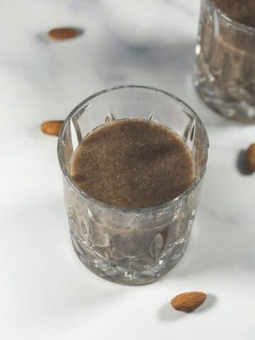 A glass of ragi malt is on the table