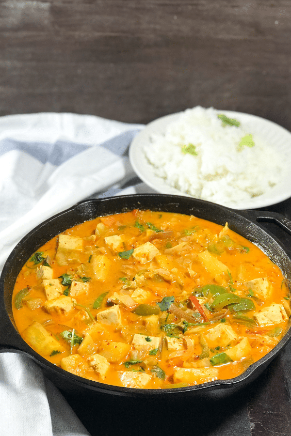 A bowl of food, with Curry and Tofu