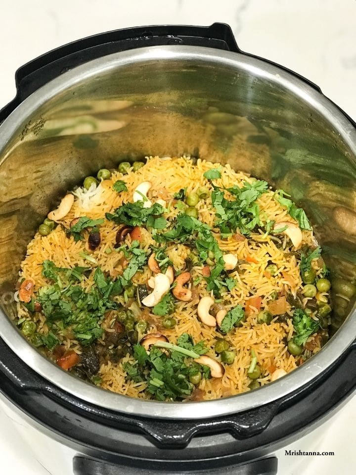 Instant Pot filled with pudina rice and nuts