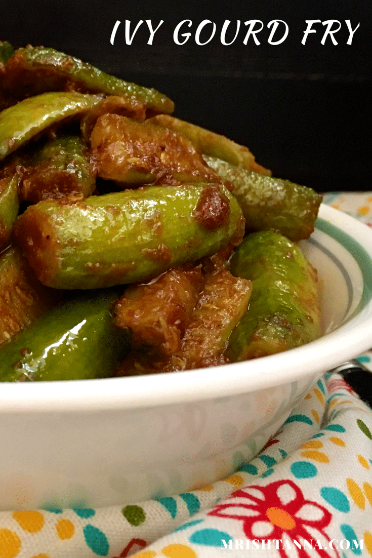 A bowl of food on a plate, with Ivy gourd and Curry