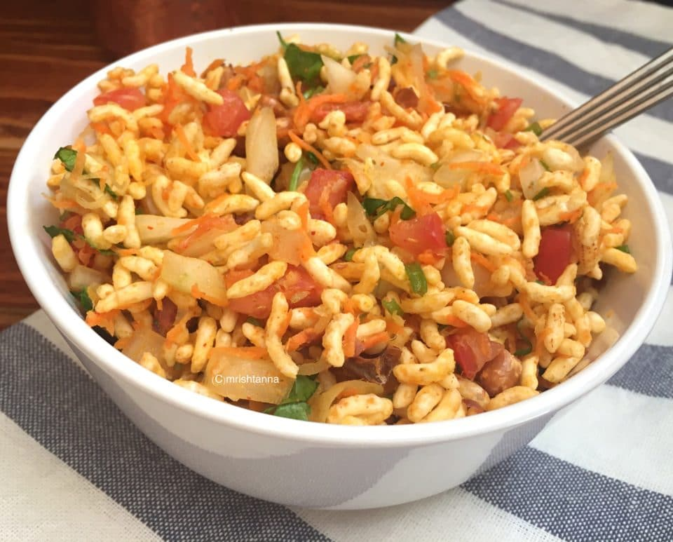 A bowl of food on a plate, with Puffed rice and Spice