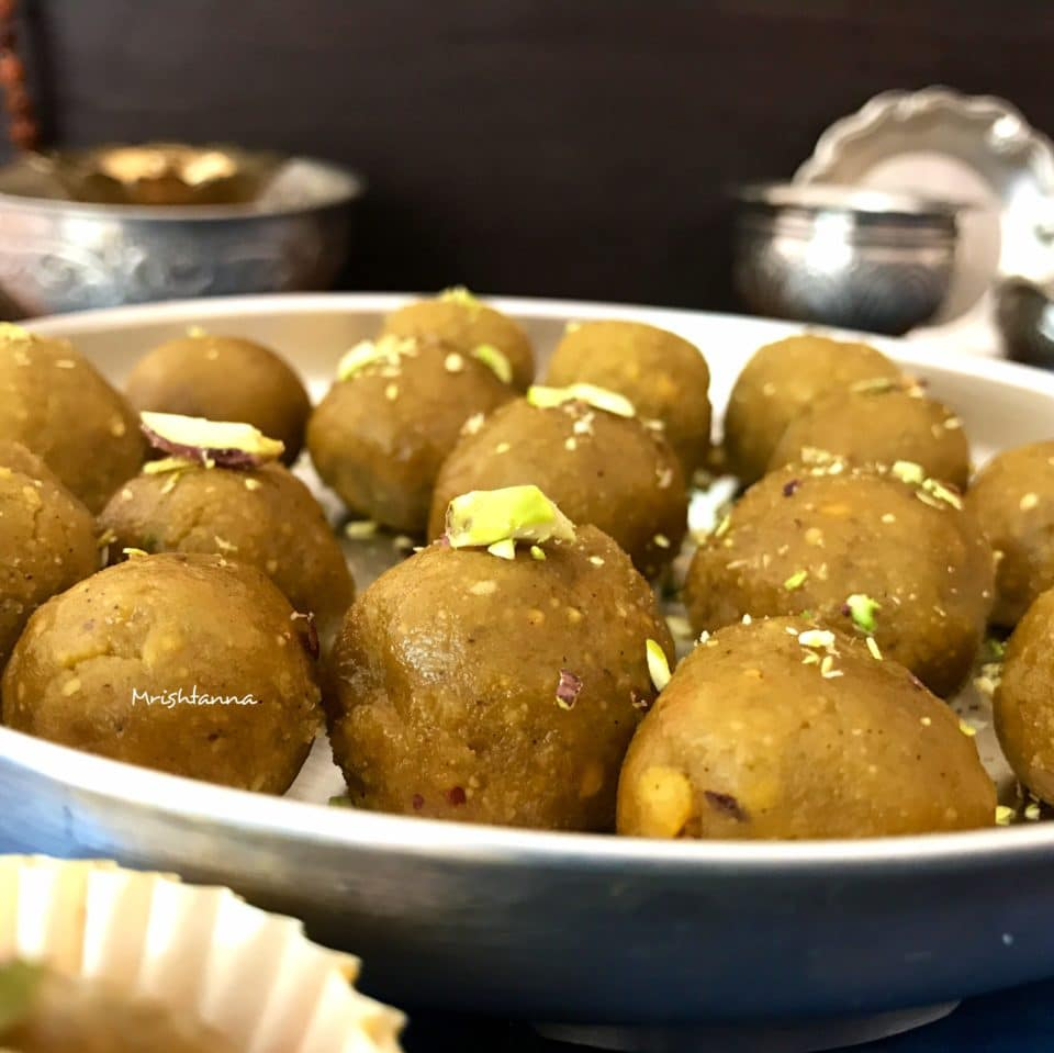 A bowl of food, with Pistachio and Laddu