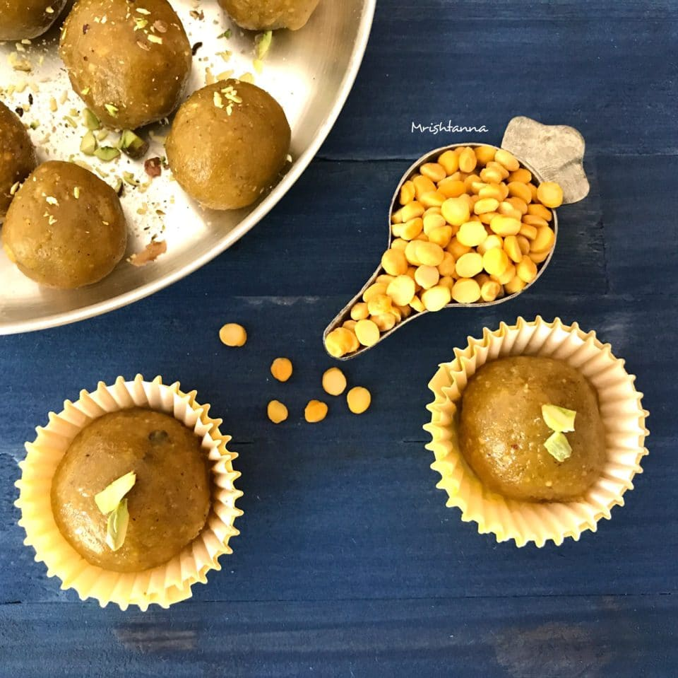 A plate of food on a table, with Pistachio and Dal