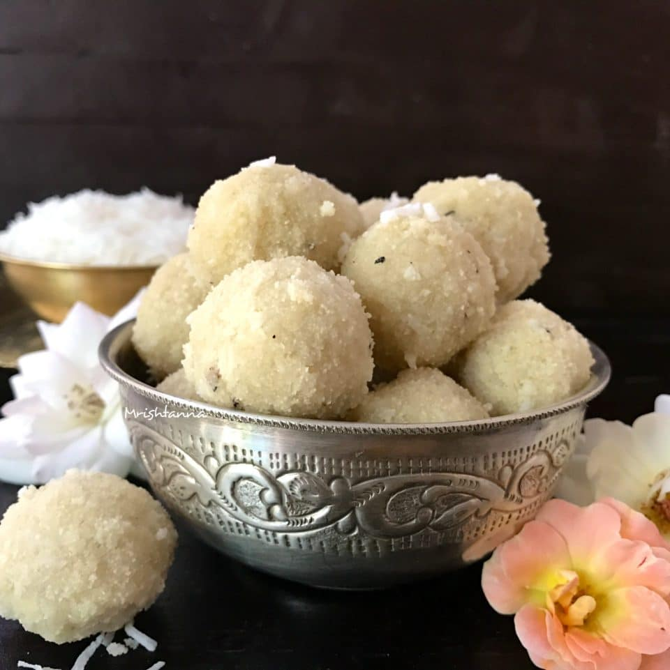 A bowl of food, with Laddu and Coconut