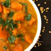 Pumpkin dal is in the white bowl