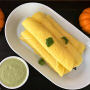 A plate of food on a table, with Pumpkin and Dosa