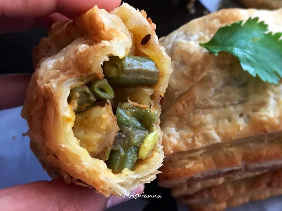 A close up of a half-eaten veg puff pastry