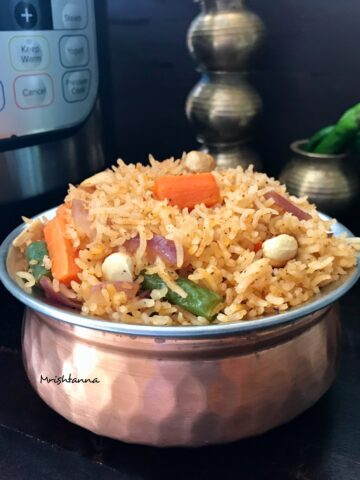 Instant Pot Vegetable Rice on a copper bowl