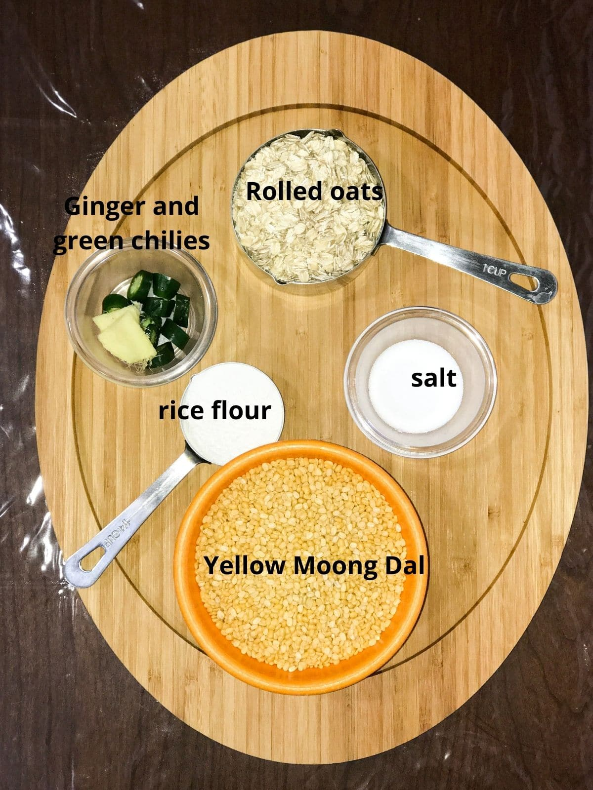 Bowls of ingredients like moong dal, oats and ginger are placed on the serving tray