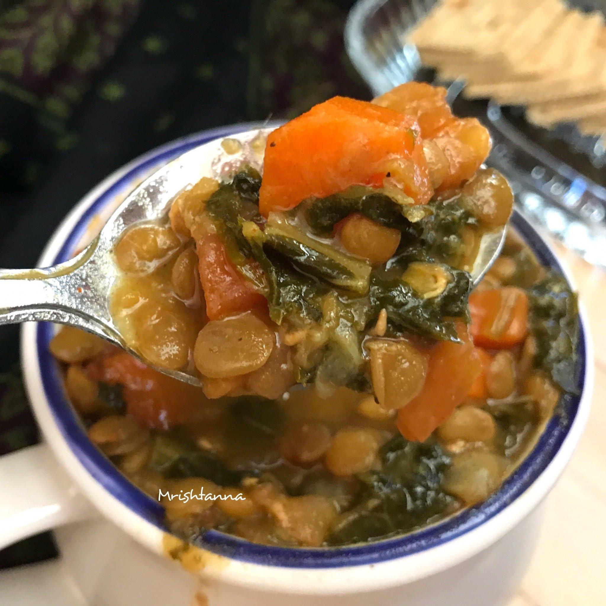 A bowl with Instant Pot Kale Lentil Soup