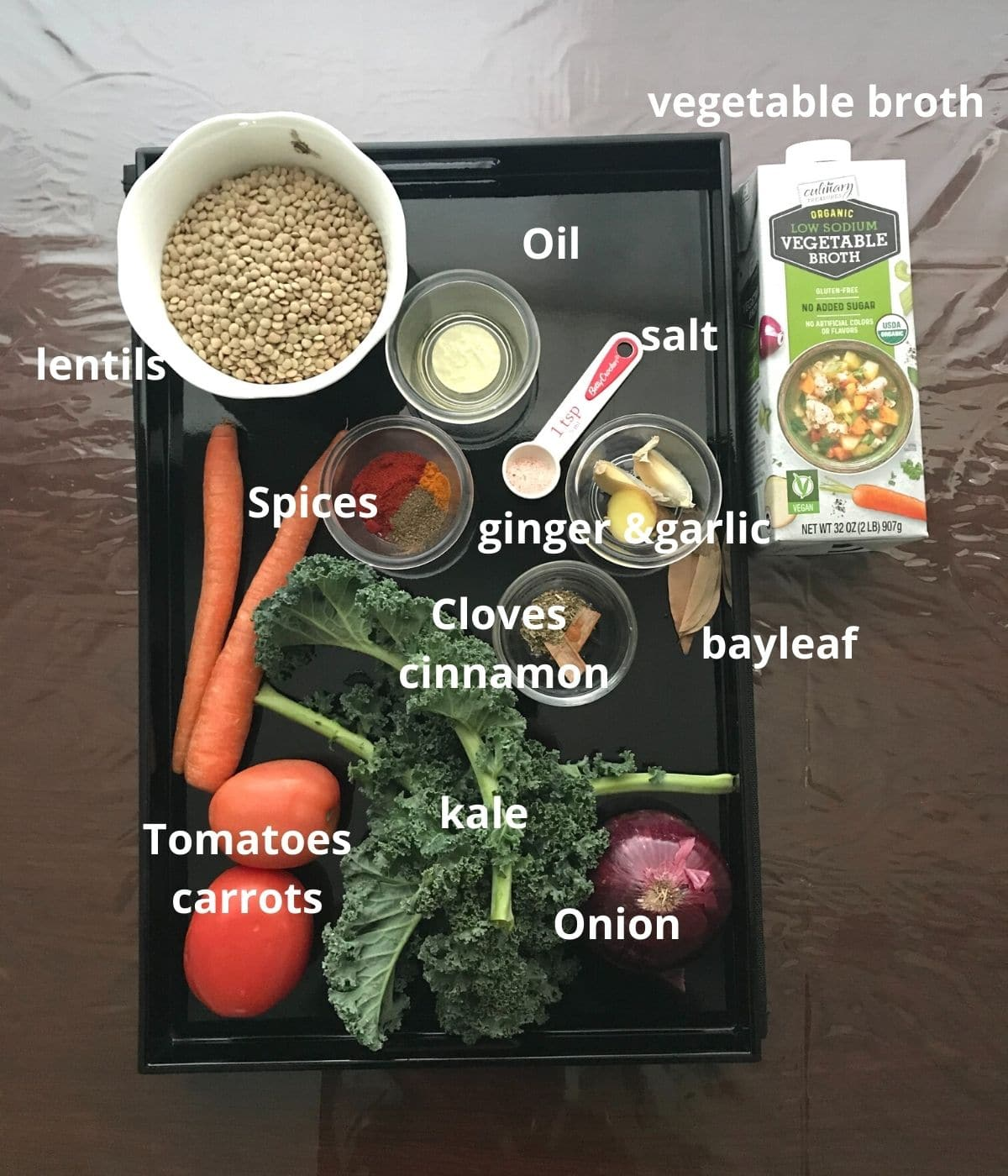 A tray is filled with all ingredients for lentil soup