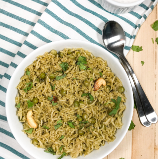 A bowl of food on a plate, with Pea and Rice
