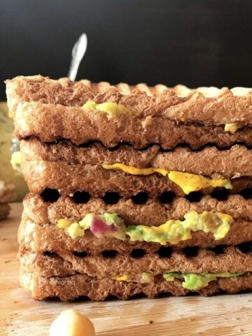 Sandwich stacked on top of a wooden table