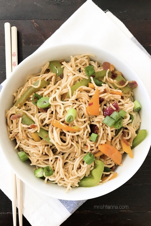 A bowl of vegan rice noodles is on the table