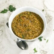 A bowl is with green gram dal is on the table