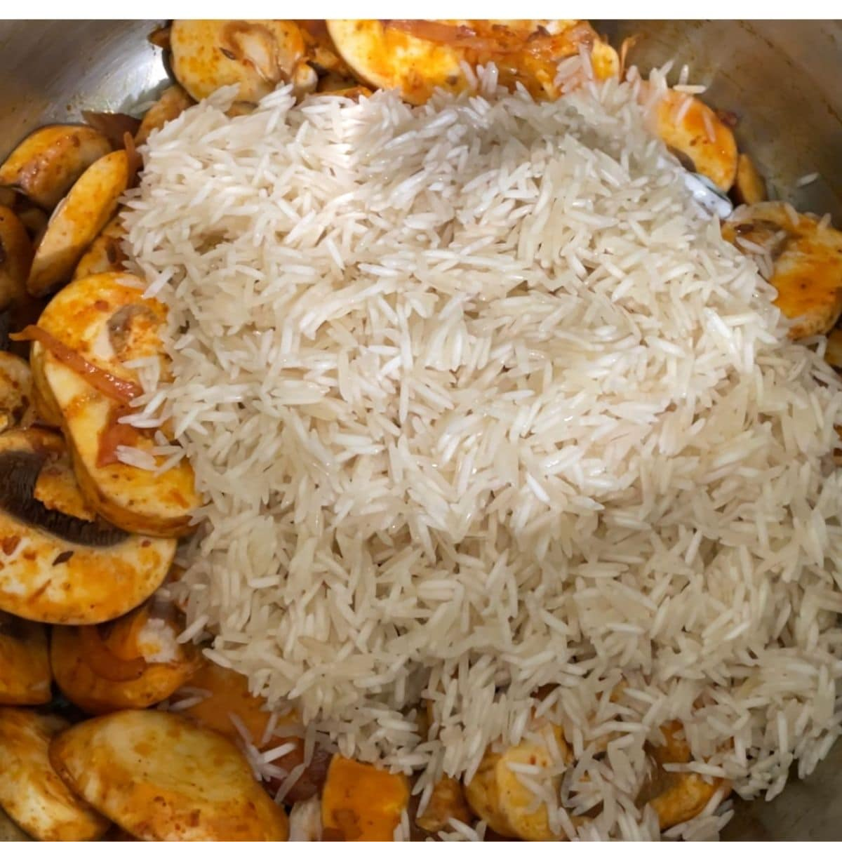 A pot filled with rice and mushrooms