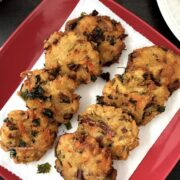 A plate of bread vada is on the table
