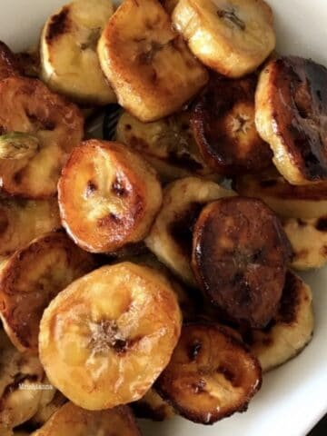 A pan is with sweet plantain on the table