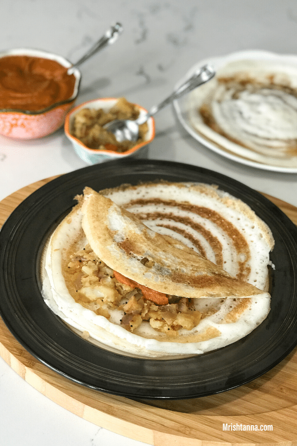 A plate of food on a table, with Dosa and Batter