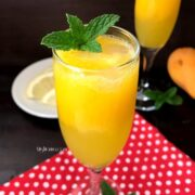 A close up of a glass of mango mocktail