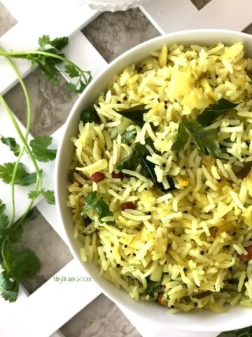 A bowl of Mango Rice and topped with cilantro