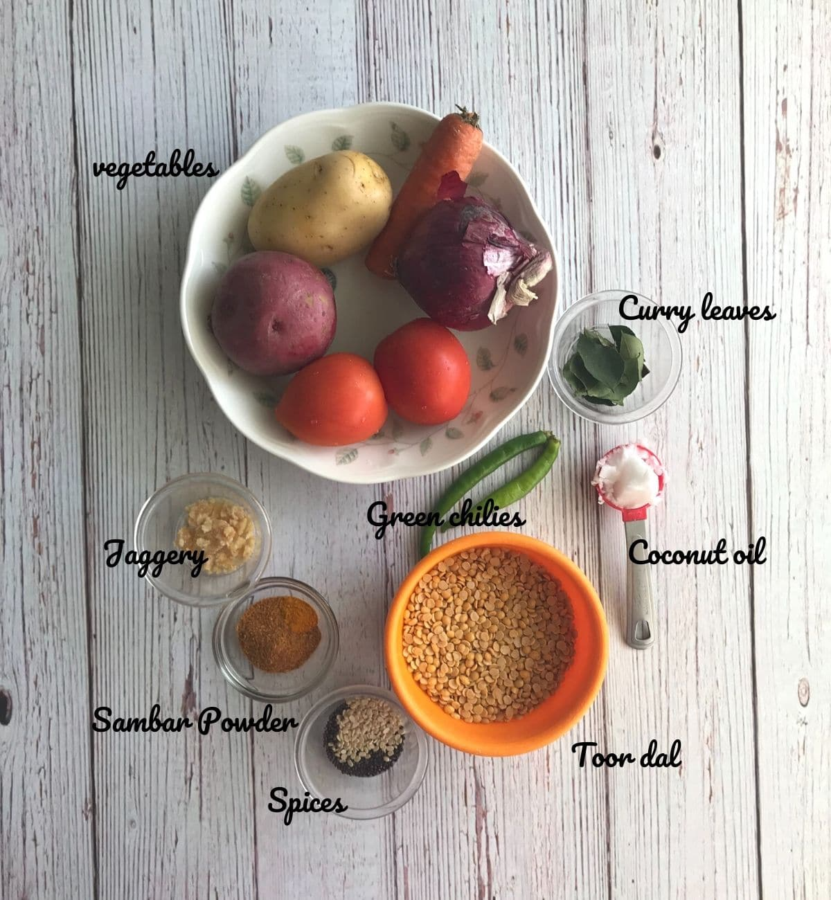 vegetables, spices are placed on the table for sambar recipe