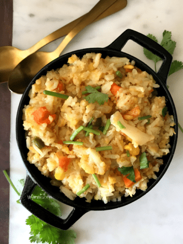 A pan filled with food, with Khichdi