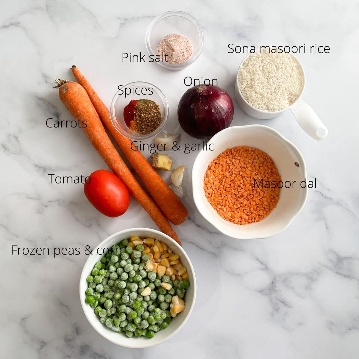 Khichdi ingredients are on the table like peas, corn, carrots, rice and lentils