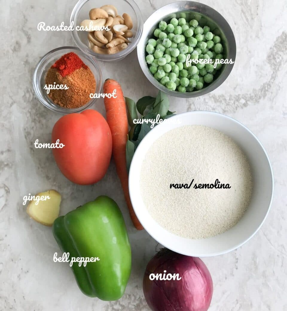 a white board is filled with masala bath ingredients like onion, capsicum, tomato, carrot, rava, and spices