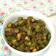 A bowl of food on a plate, with Okra