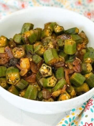 A bowl is with fried okra and onions on the table