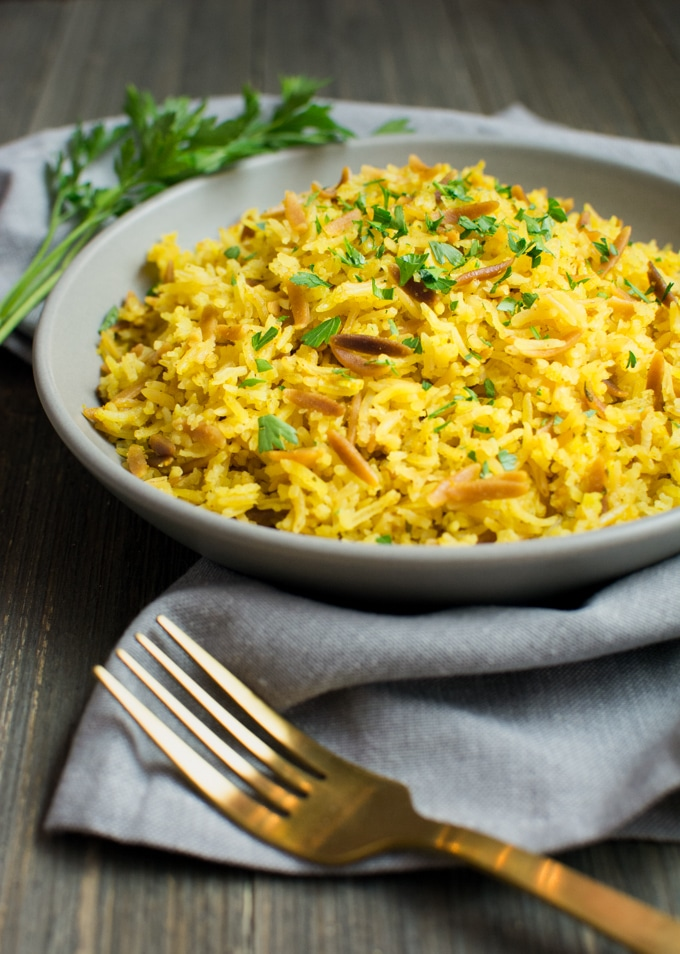 A plate of food with rice and vegetables, with Pilaf and Basmati