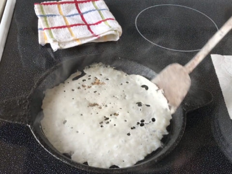 A pan of food, with Neer dosa and Rice