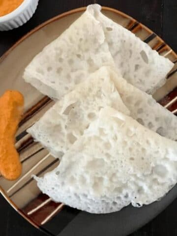 A plate of neer dosa is on the table