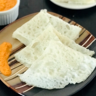 Neer dosa is placed on the plate with chutney