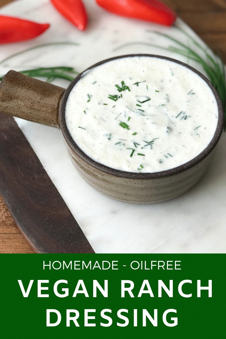 In a bowl vegan ranch dressing garnished with chives