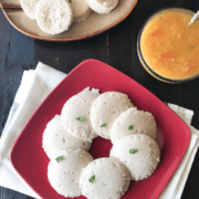 A close up of a batter, with Brown and Idli
