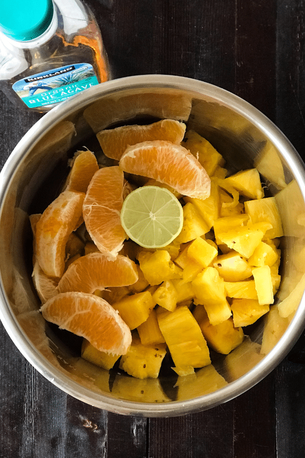 A bowl of fruit, with Jam and Pineapple