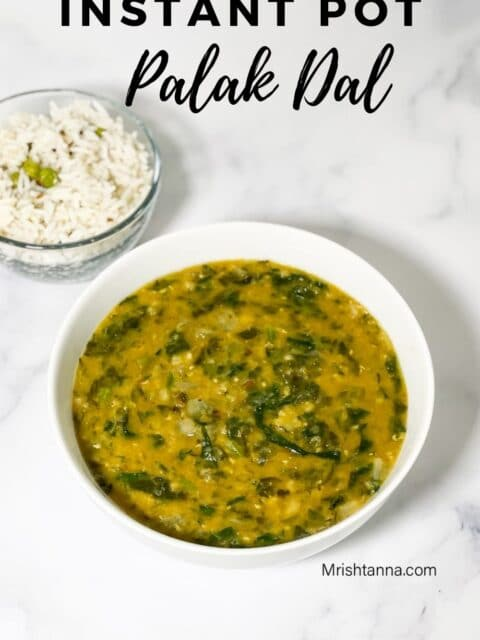 A bowl of palak dal in the white surface.