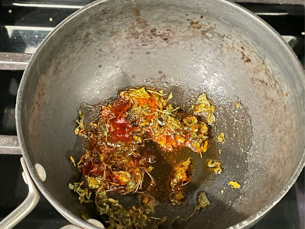A small pan is with tempering for palak dal