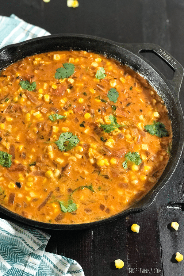 A dish is filled with food, with Curry and Coconut milk